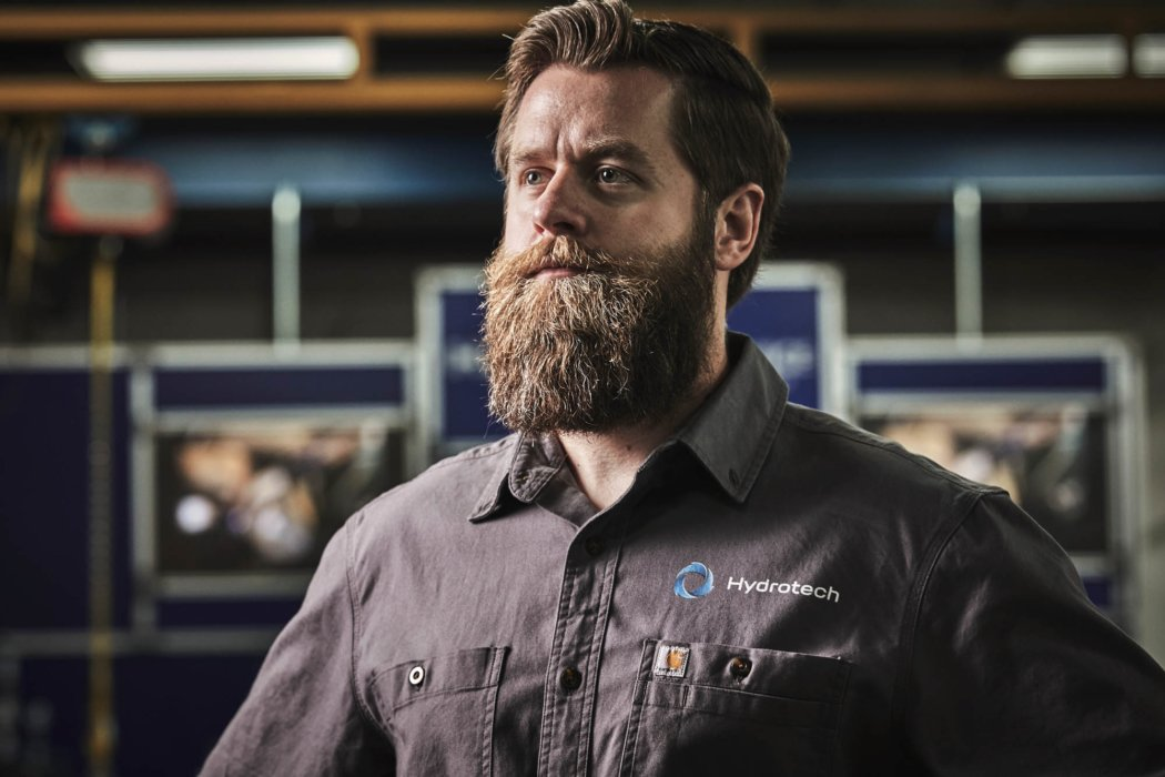 A portrait of an industrial worker with a beard - industrial photography