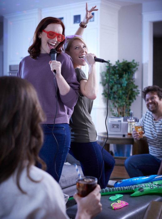 Guys and girls singing karaoke - lifestyle drink photography