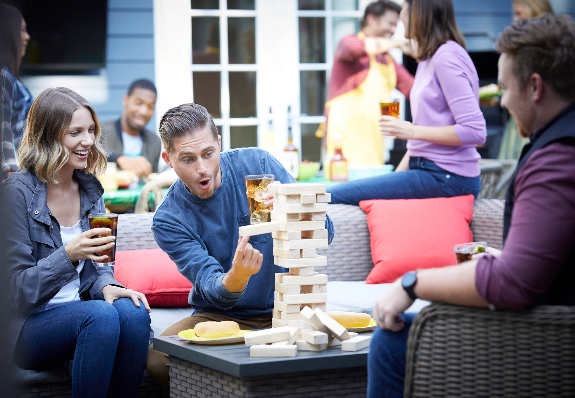 A group of friends playing jenga with rum -- lifestyle drink photography
