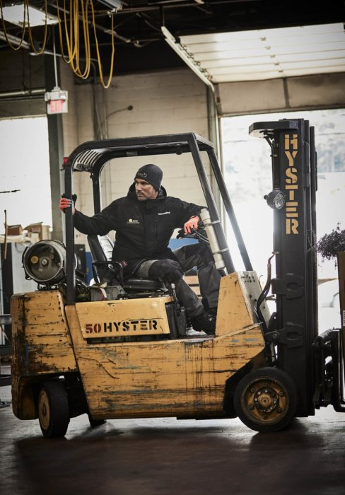 A man operating a fork lift - workplace photography