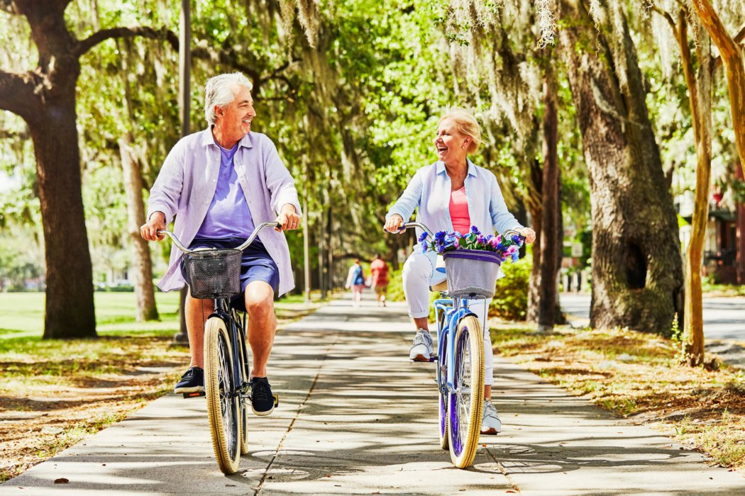 Elderly couple riding huffy bike - product lifestyle photography