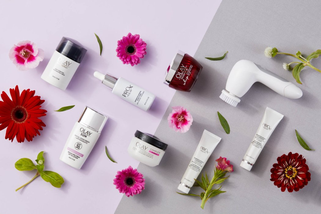 A set of olay product with flowers - product photography