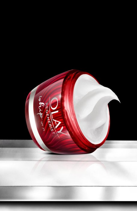 Olay regenerist whip on pedestal on black - cosmetic photography