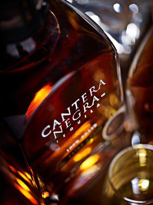 A close top down view of cantera negra tequila bottle - Drink photography