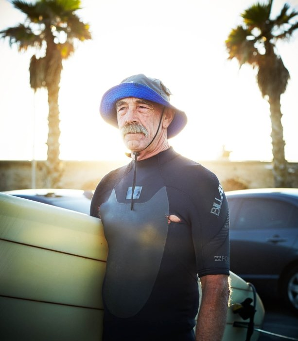 An old surfer with a mustache in California