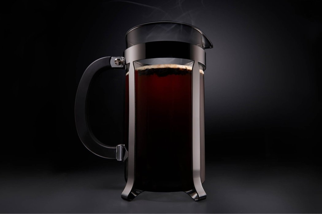 A french press with a full coffee pot