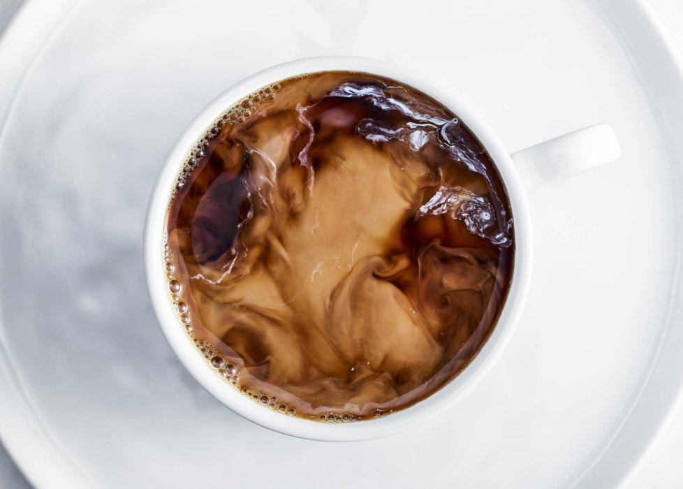 Coffee cream coffee swirling around in a white cup
