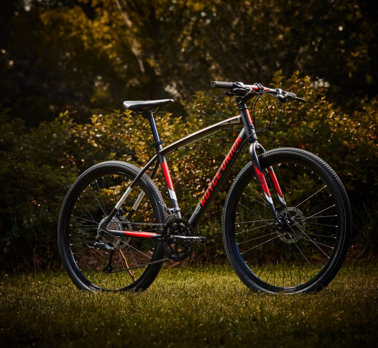 A product shot of a royce union bike on grass
