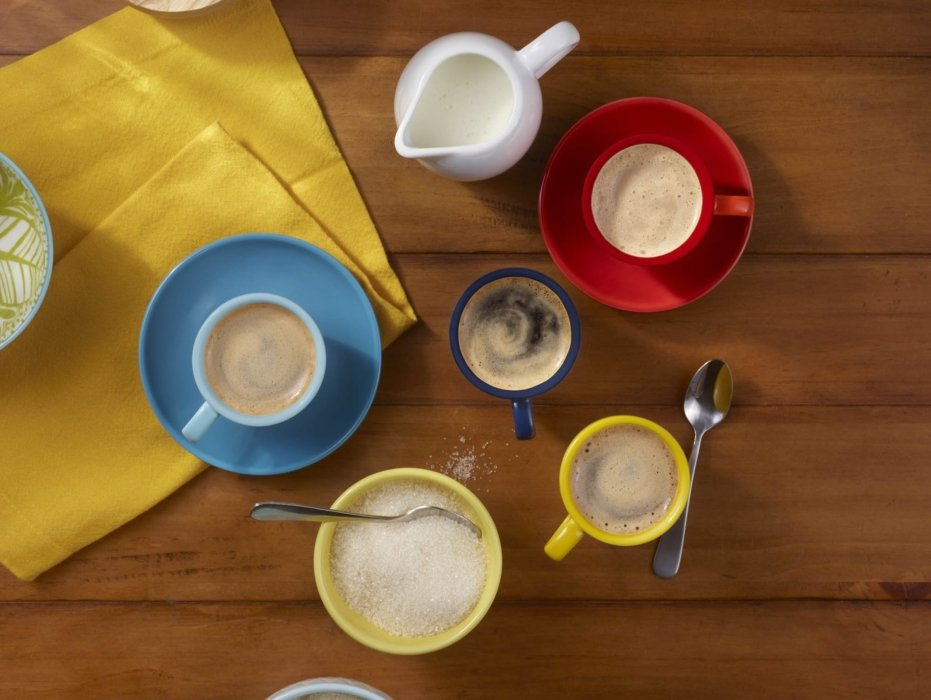 Multiple espresso cups with espresso and sugar and cream