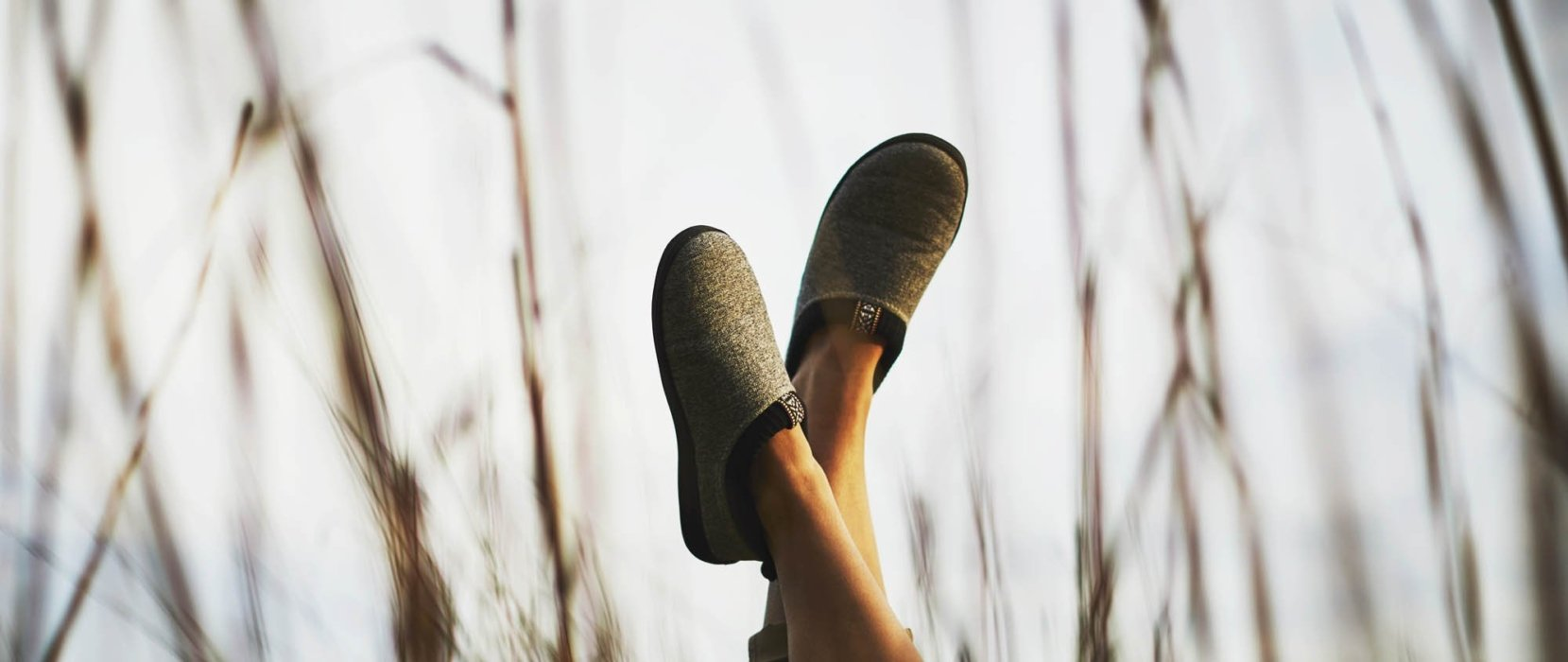 A woman's feet in the air wearing acorn shoes - apparel lifestyle photography