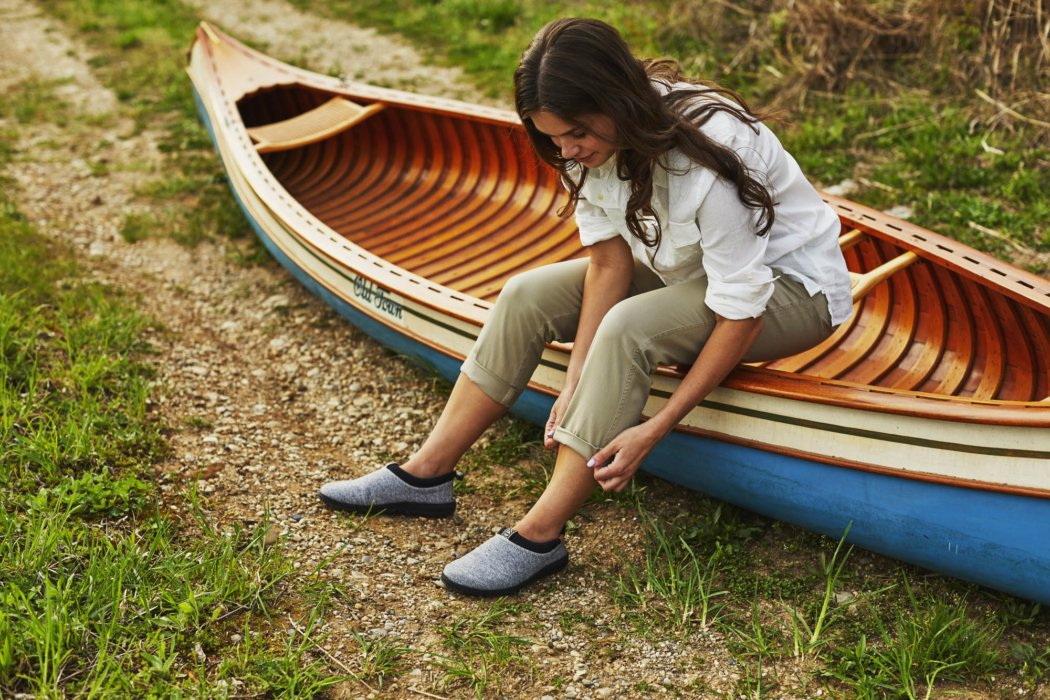 A woman's wearing acorn shoes on a boat - apparel lifestyle photography