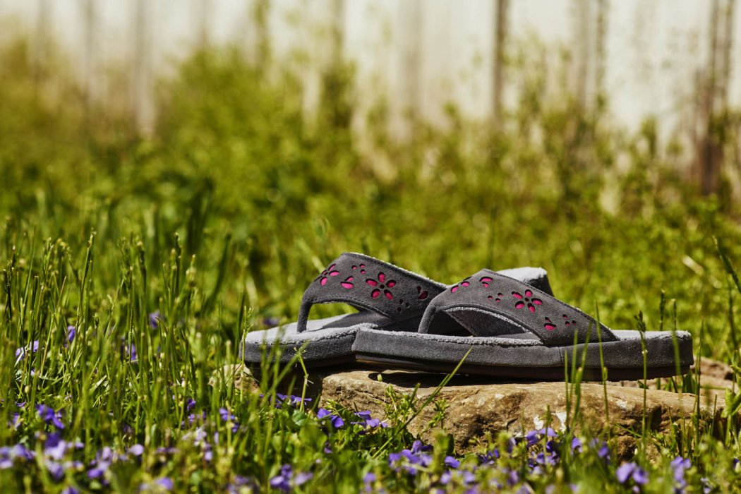 Shoes on a grass and rocky area - product photography