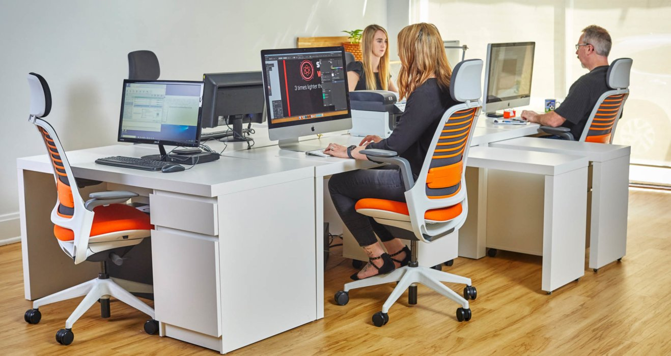 A modern office environment with people working in close proximity