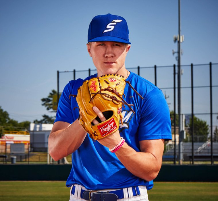 portrait of a young baseball player holding his glove