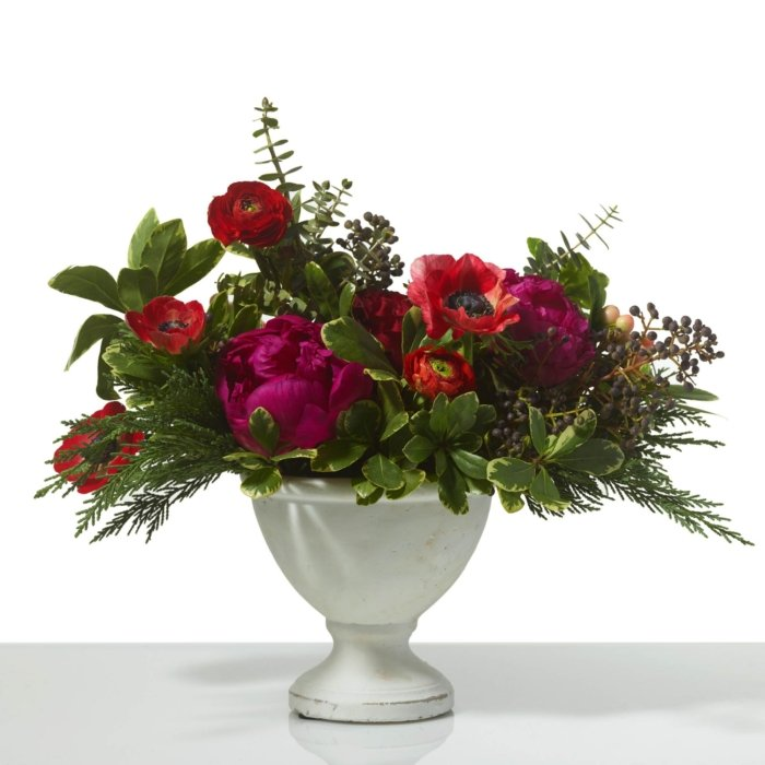 A classic style flower arrangement in a vintage stone vase