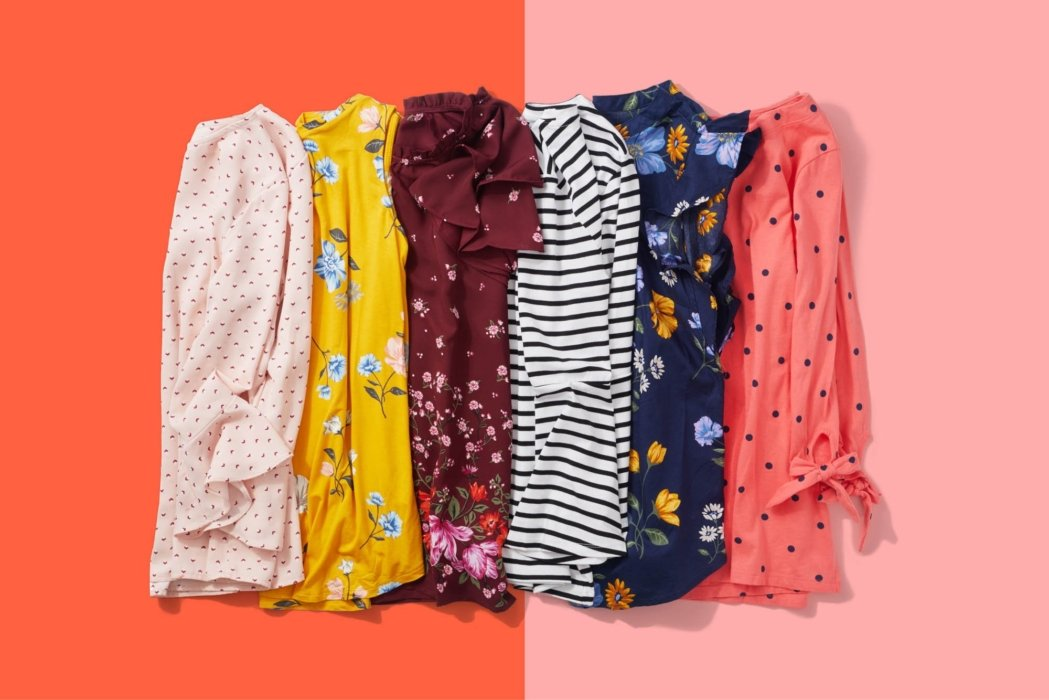 A selection of nice and colorful shirts on a orange and pink background