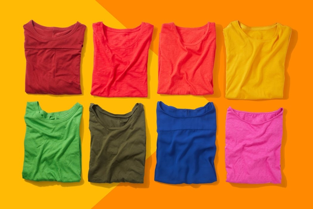 Two rows of colorful shirts on a colorful background - Product photography clothing - apparel