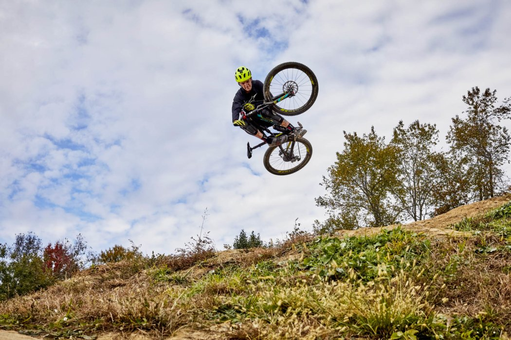 A cyclists sports athlete mid air on off road bike
