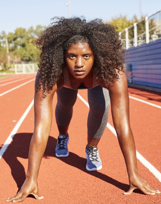 A female sports runner on a track
