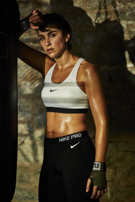 A female sport boxer taking a break wearing nike clothing