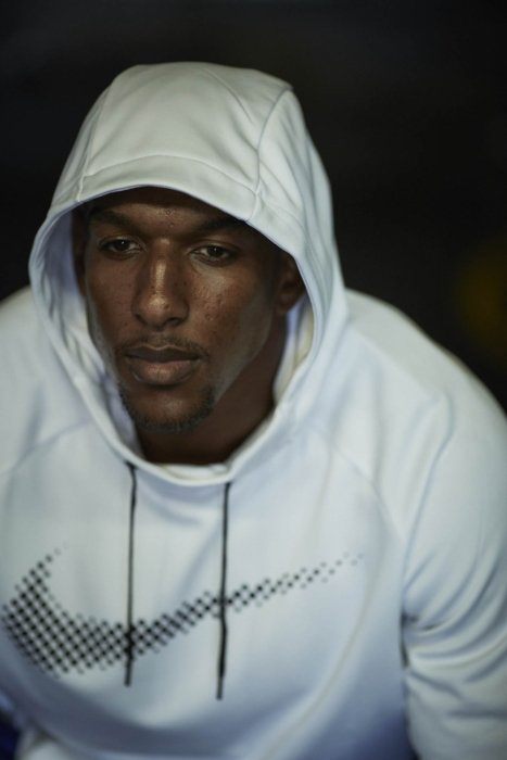 A male boxer wearing a nike hoodie