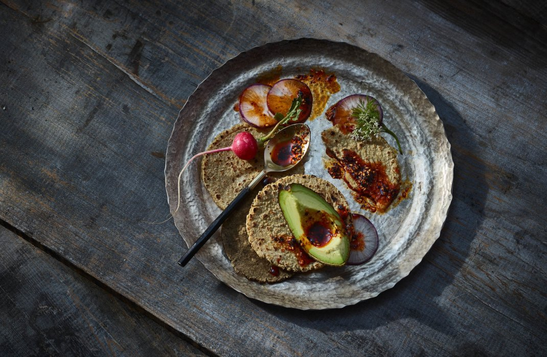 Mexico inspired editorial food photography - raw foods and veggies with tortilla