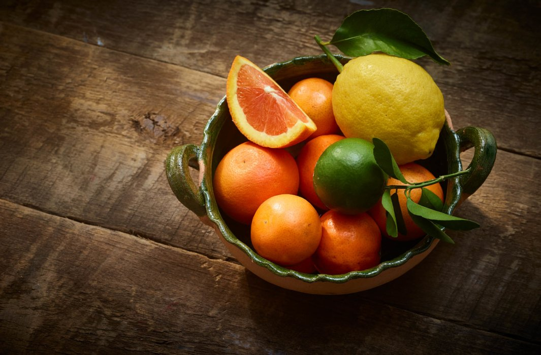 Mexico inspired editorial food photography - oranges and fruits in a bowl