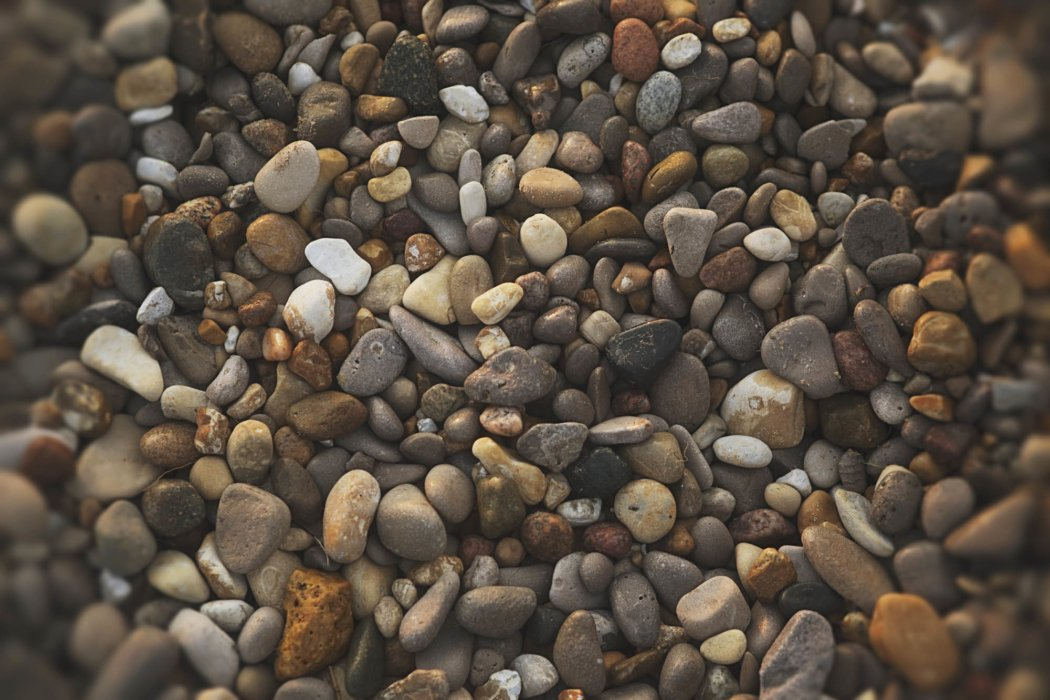 A pebble covered shore outdoors on travel