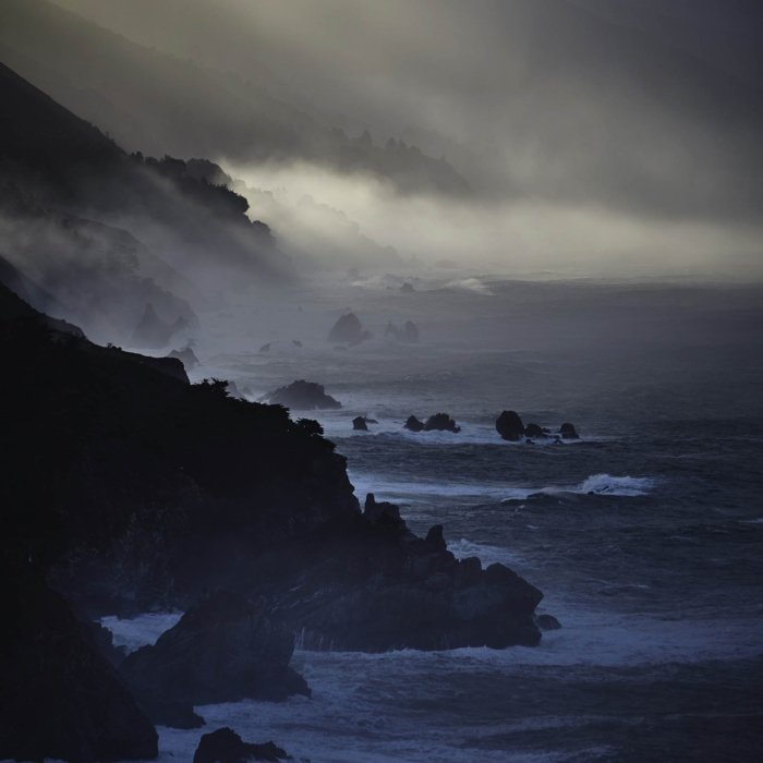 The moody misty rocky shores of a ocean coast