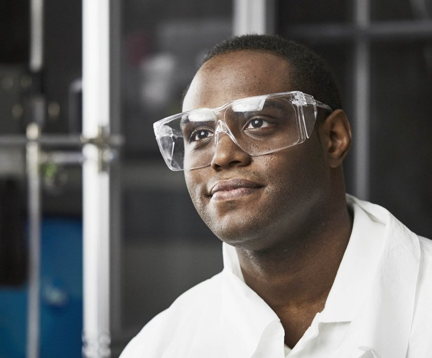 A lab worker wearing safety glasses in an lab workplace