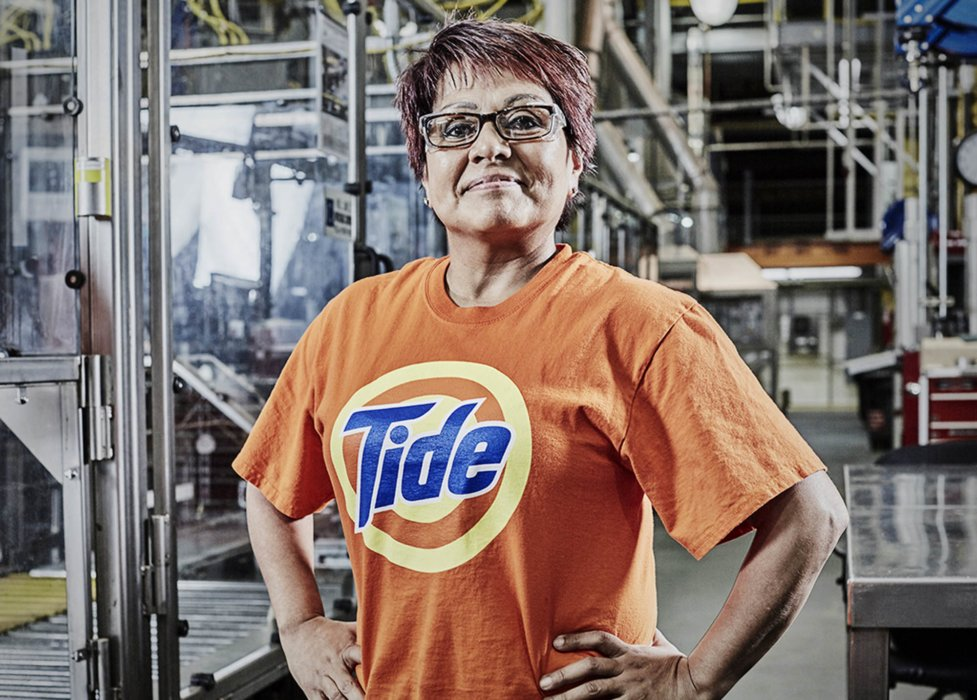 A portrait of a woman working at the Tide factory and workplace