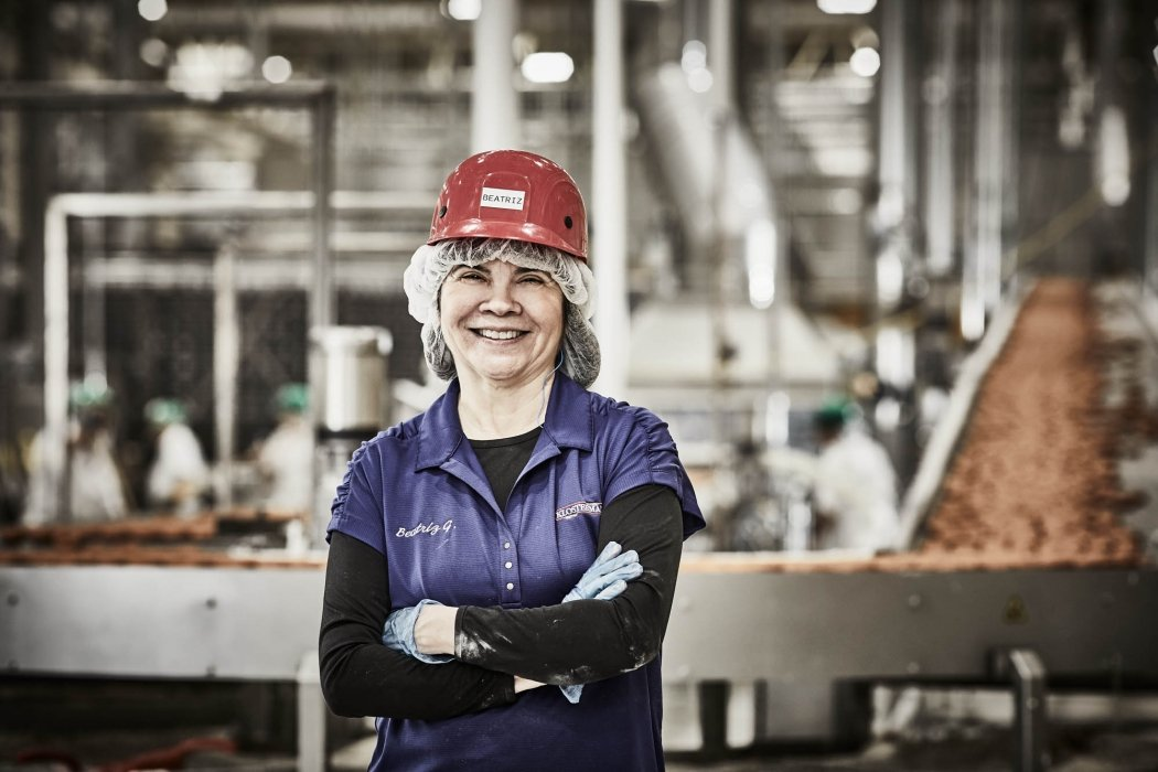 A worker smiling in a industrial factory - work photography