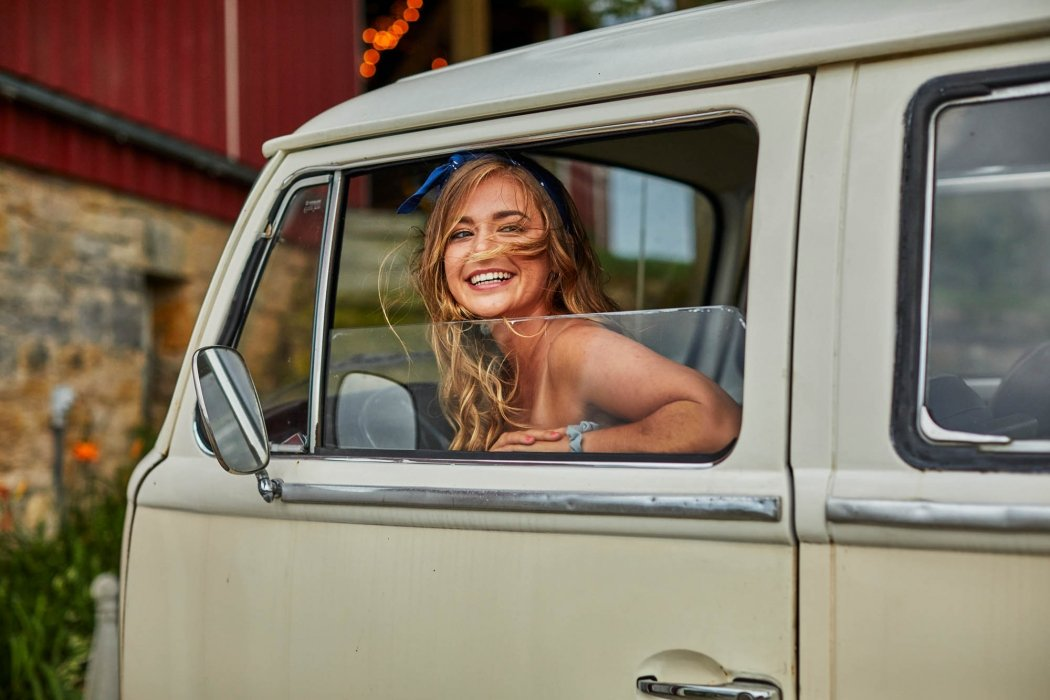 Girl with wind in her hair in vintage van - lifestyle photography