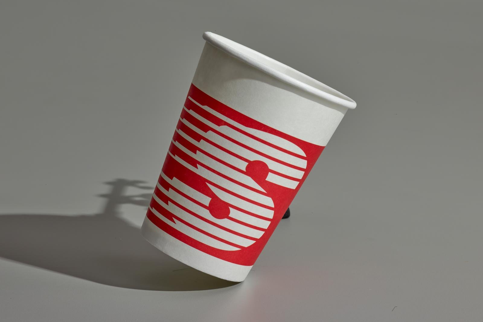 A coffee cup splashing speedway before retouching