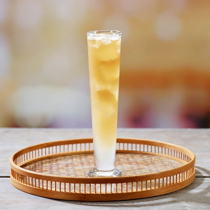 Golden whiskey cocktail on a wooden tray - drink photography