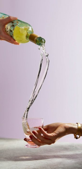 A long wine pour into a glass - splash drink photography