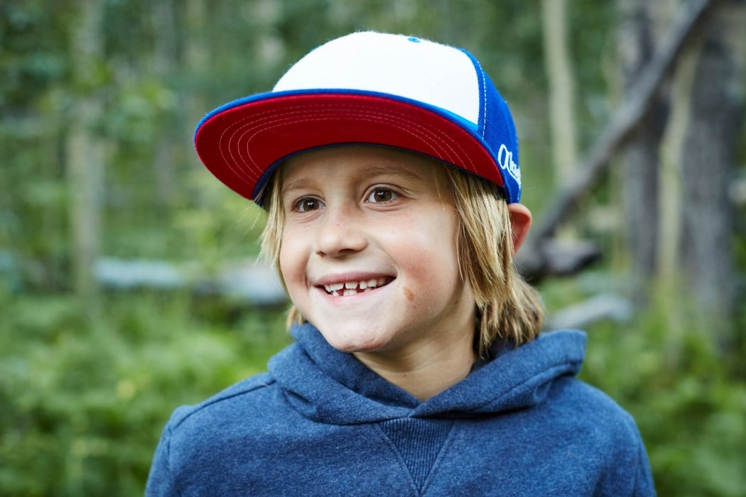 Portrait of a young boy wearing a ball cap