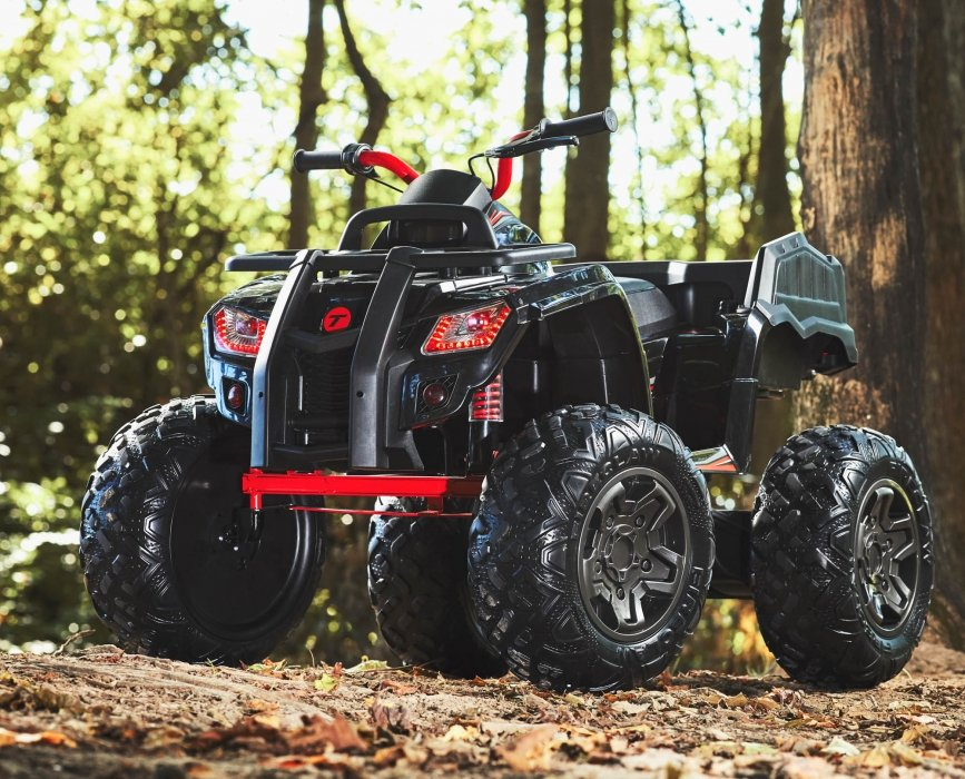 A kids 4 wheeler in a forest - product photography