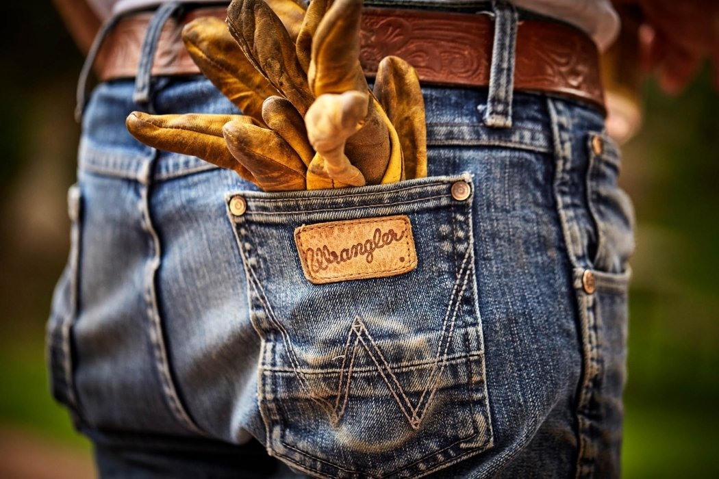 Apparel photography of wrangler jeans with work gloves - apparel photography
