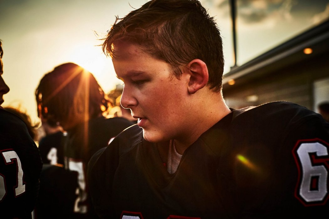 A young man at a football game in uniform - sport photography