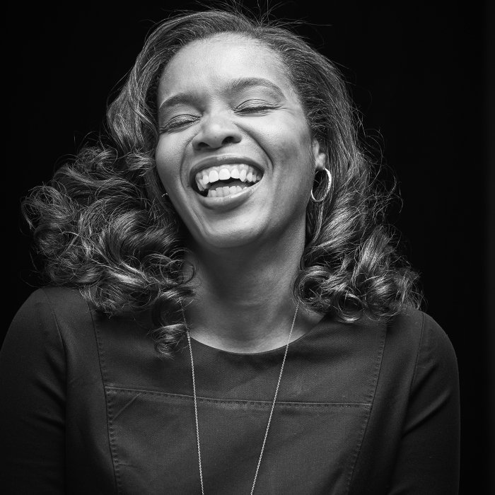 Portrait of a woman laughing in black and white