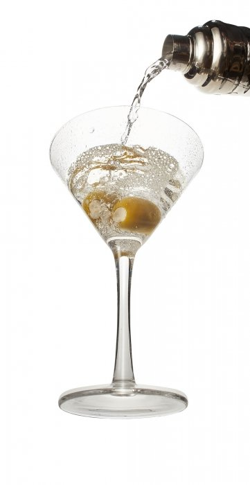 A martini being poured into a clear glass - drink photography