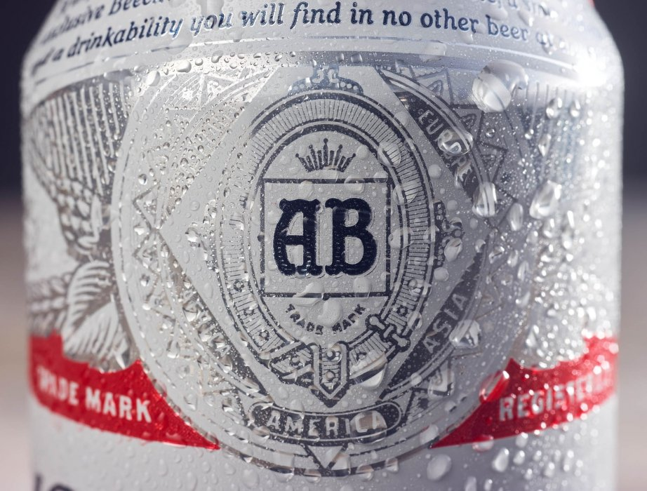 A Budwiser beer can covered in condensation - drink photography