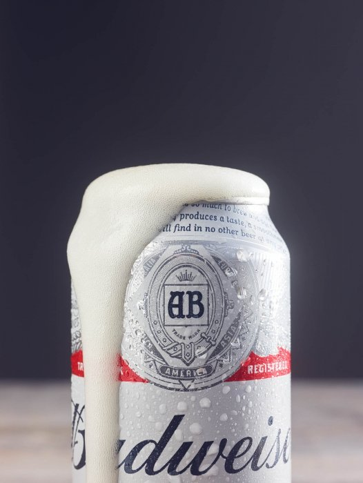 A foaming can of budwiser beer - drink photography