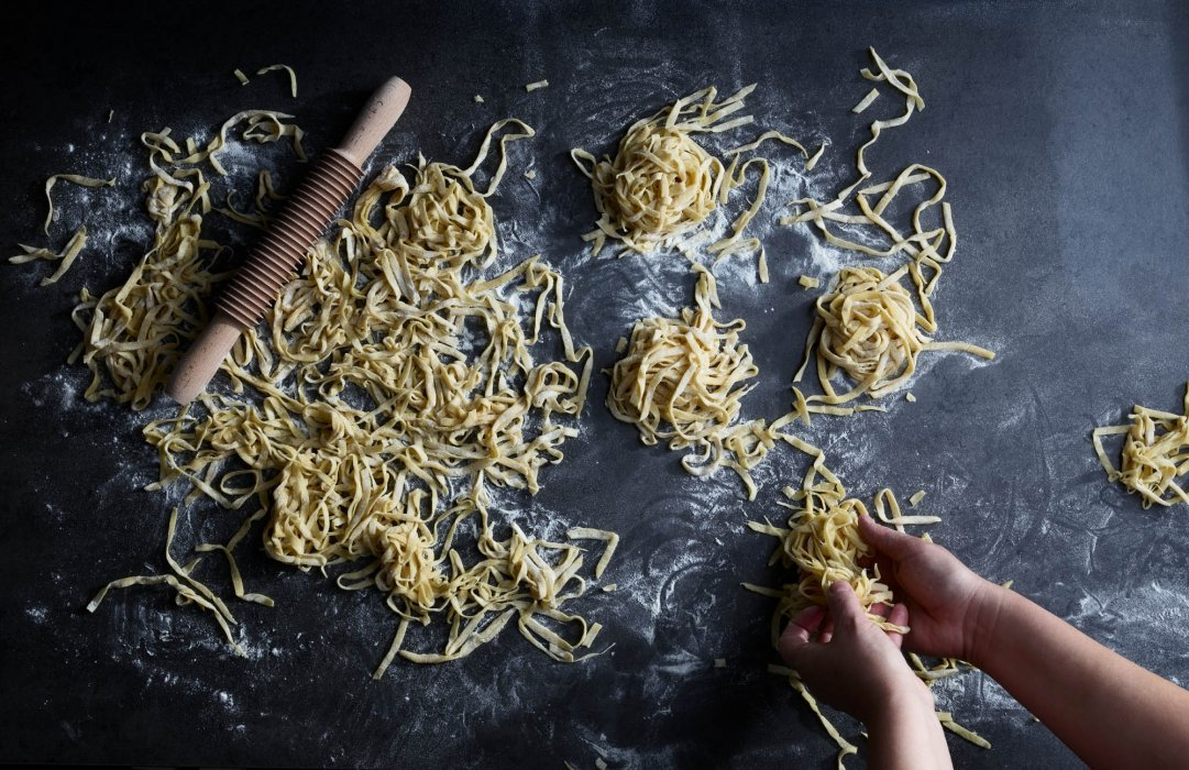 Fresh made pasta on a slate surface - food photography