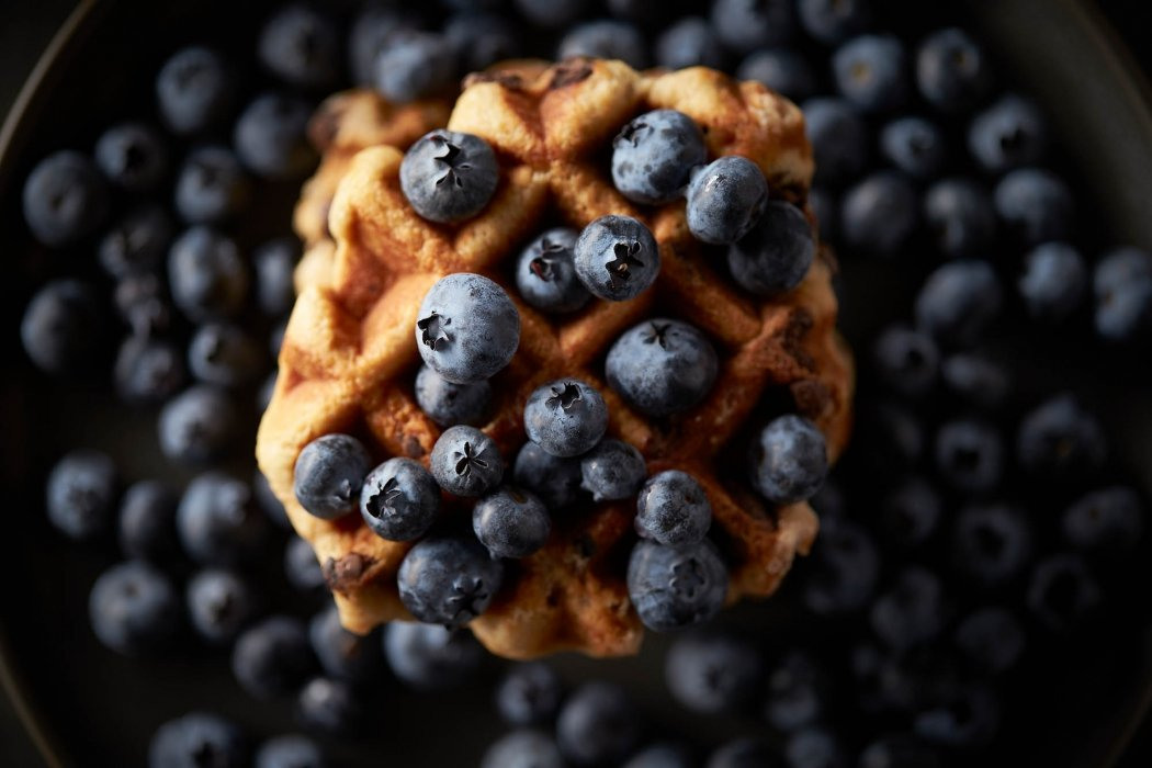 Many blueberries and a Belgian style waffle - food photography