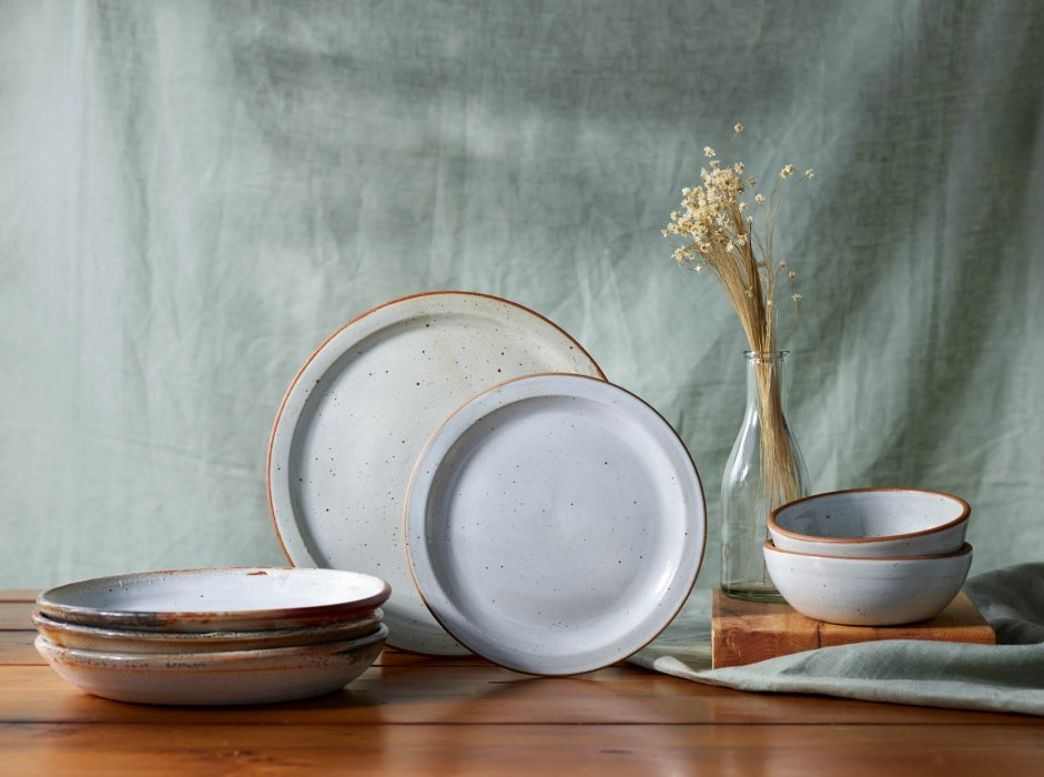 High end pottery ceramic plates and bowls - pale blue - product photography