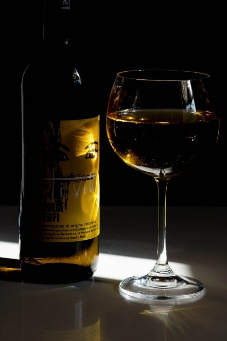 White Italian wine with bold colors and dark photo - wine photography