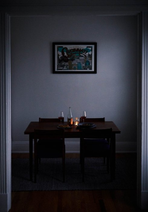 A darkly lit dinner with fine wine - wine photography
