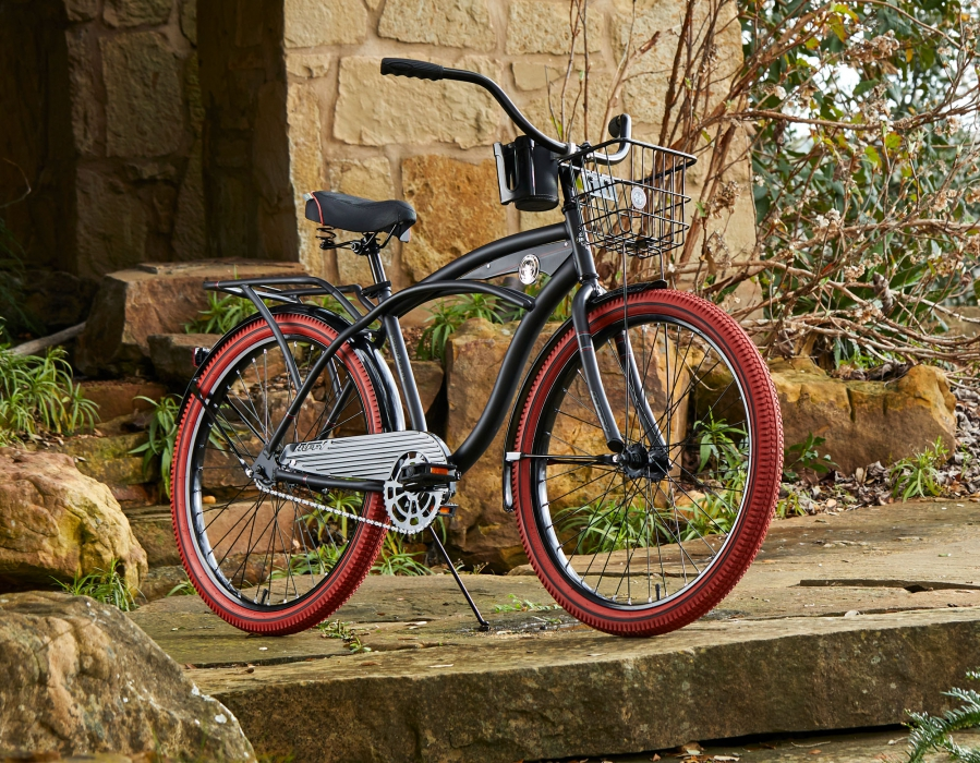 A huffy bike on in a stone covered setting red wheels vintage - product photography